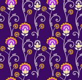Floral pattern, seamless, orange flowers on a purple background. Royalty Free Stock Images