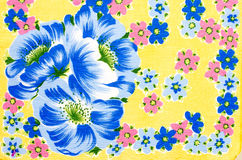 Floral pattern on yellow fabric. Stock Images