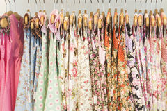 Floral pattern young girl dresses in shop. Floral pattern young girl dresses in children wear fashion shop royalty free stock image