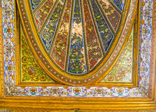 The floral patterns in Althiburos Room. TUNIS, TUNISIA - SEPTEMBER 2, 2015: The painted and gilt details of ceiling decor of the Althiburos Room in Bardo Royalty Free Stock Photos