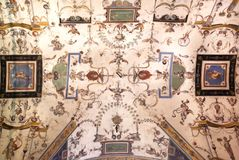 Floral patterns on fresco ceiling of 14th century building, Florence. Medieval architecture of Italy. Floral patterns on fresco ceiling of 14th century building stock image