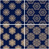 Floral patterns. Set of golden blue seamless backgrounds. Vector illustraton Stock Images