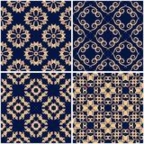 Floral patterns. Set of golden blue seamless backgrounds. Vector illustraton Royalty Free Stock Images