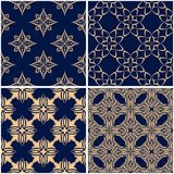Floral patterns. Set of golden blue seamless backgrounds. Vector illustraton Stock Photography