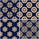 Floral patterns. Set of golden blue seamless backgrounds. Vector illustraton Stock Images