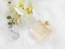 Floral perfume bottle with orchid, overhead shot Royalty Free Stock Image