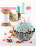 Floral pincushion in an old metal cupcake Stock Images