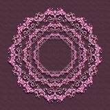 Floral pink mandala on purple background. Royalty Free Stock Photography