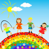 Floral rainbow with happy children. Under blue sky Royalty Free Stock Images