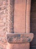 Floral red stone  carvings at entrance Royalty Free Stock Photo