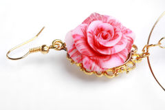 Floral rose earrings Stock Image