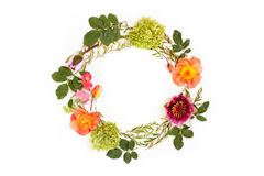 Floral round crown (wreath) with flowers and leaves. Flat lay. Top view. Creative arrangement with pink and orange roses, gray grefsheim (spiraea cinerea) Royalty Free Stock Image