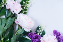Lilac, pink peonies and lilly of the walley. Floral scene of fresh flowers - lilac, pink peonies and lilly of the walley flowers close up Stock Photography
