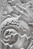 Floral sculpture design on granite wall Stock Images