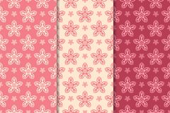 Floral seamless ornaments. Cherry red vertical backgrounds. Set of floral ornaments. Cherry red vertical seamless patterns. Wallpaper backgrounds Stock Photos