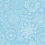 Floral seamless pattern. Seamless floral pattern on a blue background, vector Royalty Free Stock Image