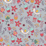 Floral seamless pattern with birds,gifts and birthday cupcakes. Stock Images