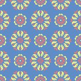 Floral seamless pattern. Blue background with colored flower elements. For wallpapers, textile and fabrics Stock Images