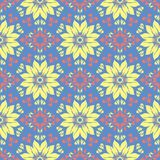 Floral seamless pattern. Blue background with colored flower elements. For wallpapers, textile and fabrics Royalty Free Stock Images