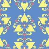 Floral seamless pattern. Blue background with colored flower elements. For wallpapers, textile and fabrics Royalty Free Stock Image