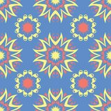 Floral seamless pattern. Blue background with colored flower elements. For wallpapers, textile and fabrics Stock Photos