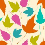Floral seamless pattern with colorful leaves on beige background. stock illustration