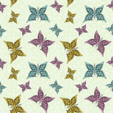 Floral seamless pattern, cute cartoon butterflies light green background. Floral seamless pattern in retro style, cute cartoon butterflies light green background Royalty Free Stock Photo