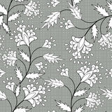 Floral seamless pattern, cute cartoon flowers  gray specks  background Stock Photo