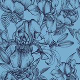 Floral seamless pattern with iris, lilies and roses on the blue background Royalty Free Stock Photos