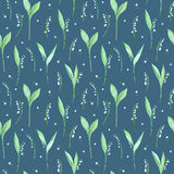 Floral seamless pattern of a lily of the valley flowers. Watercolor hand drawn illustration. Dark blue background Royalty Free Stock Photos