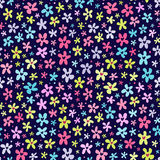 Floral seamless pattern with little bright flowers. Cute floral seamless pattern with little bright flowers on dark blue background Stock Images
