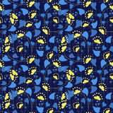 Floral seamless pattern in retro style on blue background. Floral seamless pattern in retro style, cartoon cute flowers on blue background specks Stock Photography