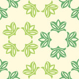 Floral seamless pattern. Vector illustration. Floral seamless pattern with green leaves. Vector illustration on light green background Royalty Free Stock Images