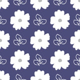 Floral seamless pattern. White flowers and outlines of leaves on a blue background. Royalty Free Stock Images