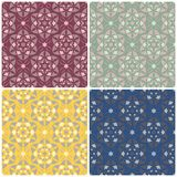 Floral seamless patterns. Set of colored backgrounds with flower elements. For textile and wallpapers Stock Image