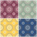 Floral seamless patterns. Set of colored backgrounds with flower elements. For textile and wallpapers Royalty Free Stock Photography