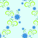 Floral seamless texture. Repeated floral pattern on a blue background Stock Image