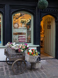 Floral shop display, Butchers Row, Shrewsbury. SHREWSBURY, UNITED KINGDOM - JANUARY 30, 2016 - Gift Craft shop with a wheelbarrow floral display outside Stock Photo