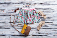Floral skirt and aviator sunglasses. Royalty Free Stock Photo