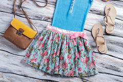 Floral skirt and blue top. Royalty Free Stock Photo