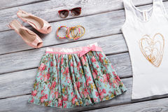 Floral skirt and sunglasses. Royalty Free Stock Images