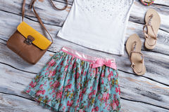 Floral skirt and white top. Royalty Free Stock Image