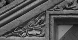 Floral stairs with some animals on it part 5. Shot in black and white and detail of the sculpture on the facade of this historic building representing some royalty free stock images