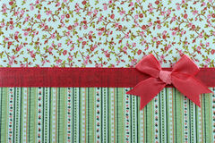 Floral and stripe fabric with ribbon. A pretty cover for a book, album, whatever with floral fabric and a ribbon Stock Photo