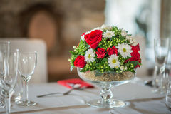 Floral table centerpiece with roeses and daisy, celebration wedding or birthday, table decoration Stock Image