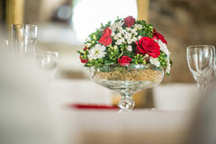 Floral table centerpiece with roeses and daisy, celebration wedding or birthday, table decoration Stock Photos