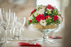 Floral table centerpiece with roeses and daisy, celebration wedding or birthday, table decoration Royalty Free Stock Photo