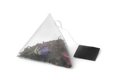 Floral tea bag. On white royalty free stock image