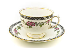 Floral tea cup. Floral patterned tea cup with saucer on a white background Royalty Free Stock Photos