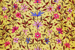 Floral textile. Decorative textile with handcrafted colorful floral pattern Stock Photo